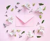 Flowers and envelope on a light pink background