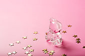 Glamour glass toy bear with golden stars on bright pink