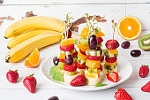 Fresh fruit on skewers. Concept buffet for a summer party.