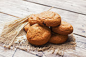 Natural oatmeal cookies on wooden background. Rustic style. Copy space