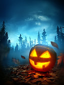 Halloween Background With a Spooky Jack O Lantern At Night
