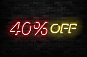 Vector realistic isolated neon sign of Neon Sale Discount 40 Percent icon for template decoration on the wall background. Concept of Black Friday and winter holidays.