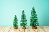 Christmas holiday celebration concept with Christmas tree on wooden table.
