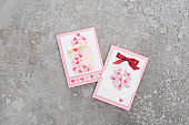 top view of valentines greeting cards on concrete grey background