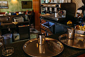 selective focus of metallic round trays and cups on bar counter in cafe, barcelona, spain
