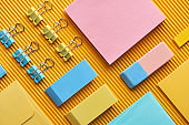 flat lay of colorful arranged stationery supplies on yellow