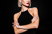cropped view of glamour woman in earrings and black dress, isolated on black