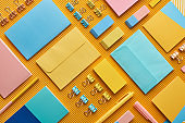flat lay of colorful arranged office stationery supplies on yellow