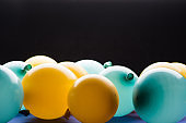 Selective focus of yellow and blue balloons isolated on black