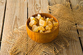 Food and healthy eating concept. Dried ginger with sugar on wooden table