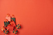 top view of gift boxes and shopping bags on red background with copy space