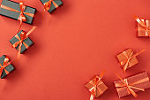 top view of small gift boxes on red background with copy space