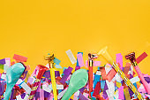 Top view of party decoration on yellow festive background