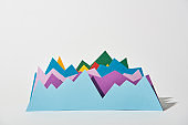 blue, purple, green, red and yellow paper graphs on white background