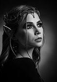 Monochrome portrait of attractive young elf in tiara.