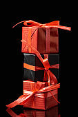 black and red decorative gifts isolated on black