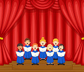 Choir children singing a song on the stage
