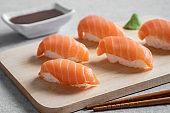 Salmon nigiri sushi on wooden plate, Japanese food