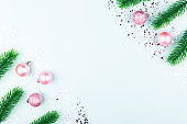 Christmas or New Year composition. Pink decoration, snow flakes and glitter.