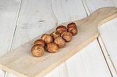 Tasty brown hazelnut on grey wood