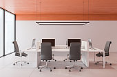 Modern open space office with orange ceiling