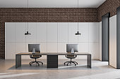 White and brick office workplace