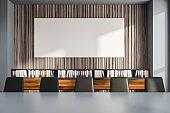 Gray and wooden conference room with poster
