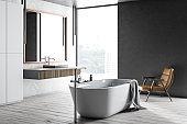 Gray and white wood bathroom corner, tub and sink