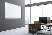 Gray office workplace with poster