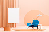 Peach living room with blue armchair and poster