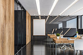 Gray and wooden office interior with poster