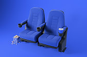 Two blue comfortable cinema chairs on blue