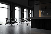 Loft style pub interior with chairs and stools