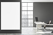 Gray manager office workplace with poster