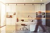 Man walking in white CEO office