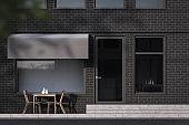 Dark brick outdoor cafe exterior