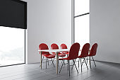 White conference room corner with red chairs