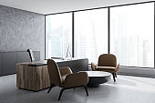 Concrete CEO office corner, leather armchairs