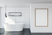White tile bathroom with mock up poster