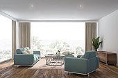 White living room interior, blue sofa