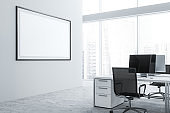 White office workplace with poster