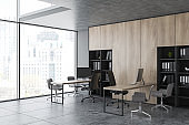 Gray and wood open space office corner