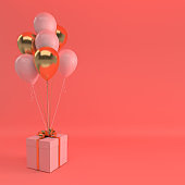 3d render illustration of realistic golden and pink balloons and gift box with bow on coral colored background. Empty space for party, promotion social media banners, posters.