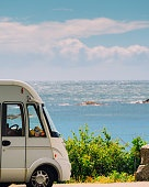 Camper car on coast of Norway with ocean view