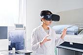 Young laboratory scientist in VR simulator
