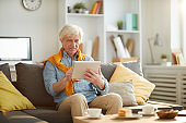 Modern Senior Man Using Tablet at Home