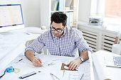 Engineer Working at Desk