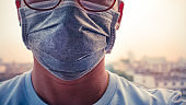 Asian men wear a health mask to prevent dust PM2.5 on the background of Bangkok.