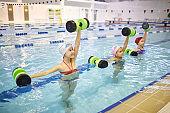 Girls exercising in pool