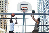 Guys Scoring Goal in Basketball